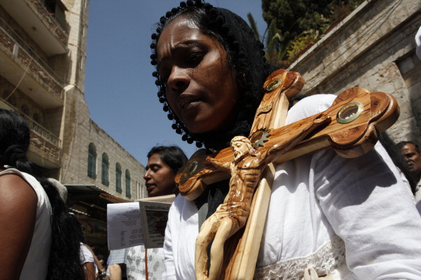 A Christian pilgrim carries a crucifix miracle